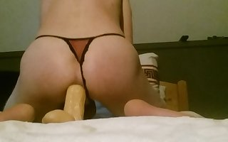 me fucking my biggest dildo while locked in chastity